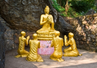 Buddha and monks statue meditaing, Laos.